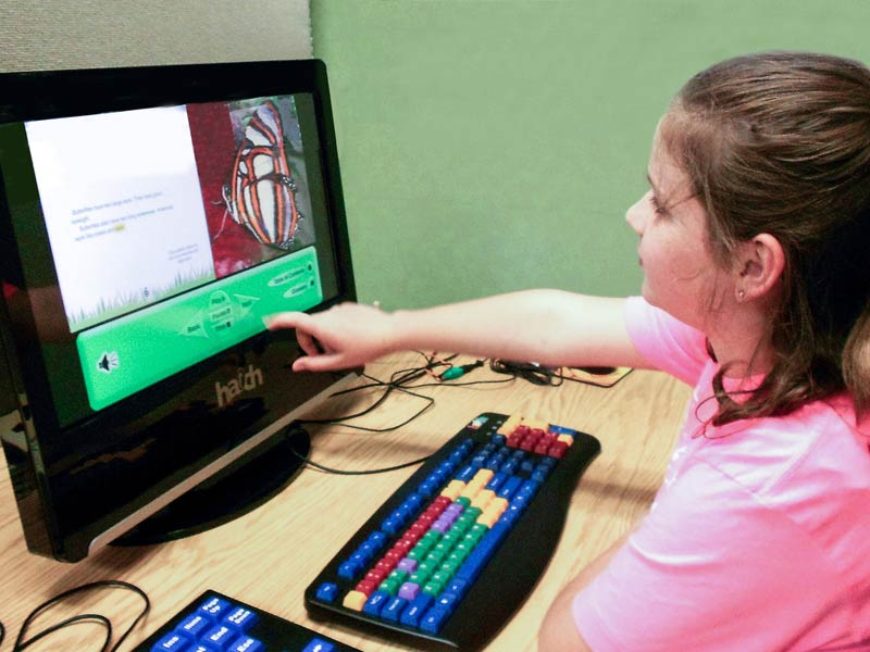 Disabled child on assistive technology